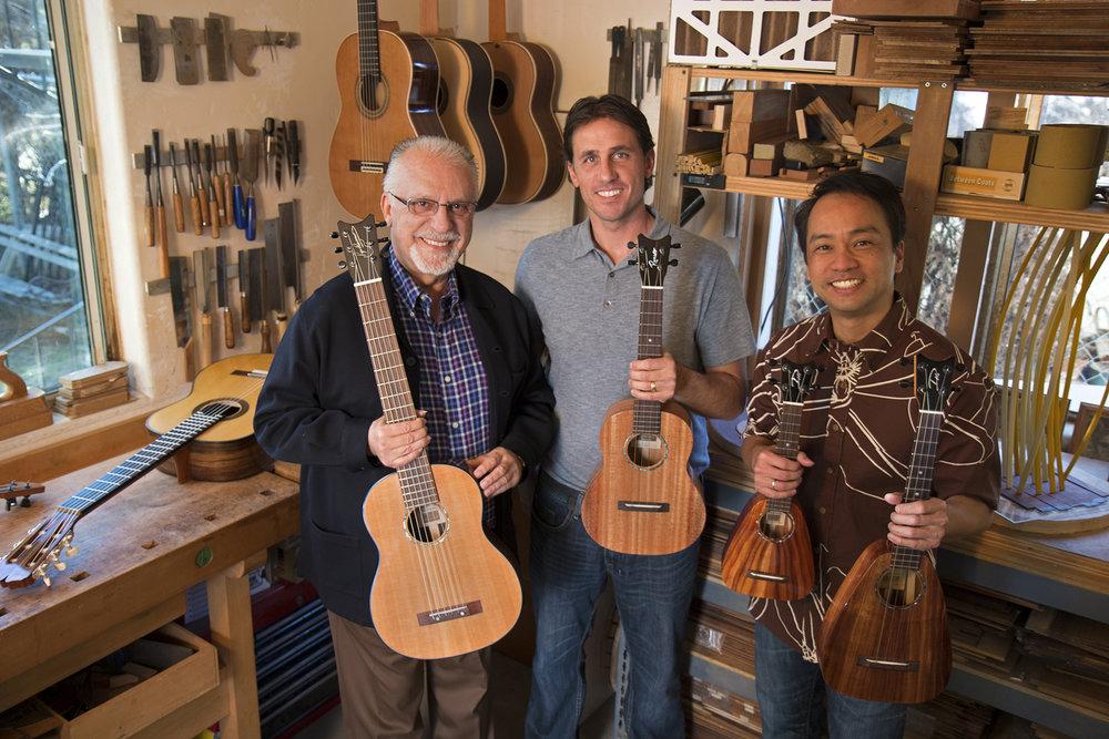 L-R: Pepe Romero Sr., Pepe Romero Jr., Daniel Ho • holding L-R: Pepe Romero Signature Six-String, Grand Tenor 'ukulele, XS Soprano 'ukulele, Tiny Tenor 'ukulele