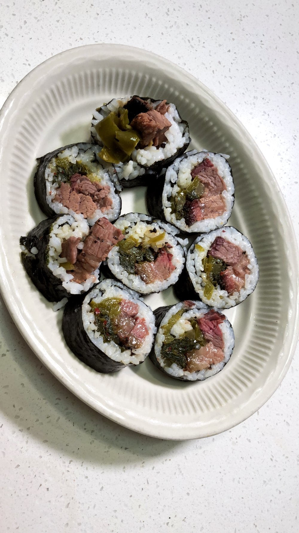 Kimbap filled with smoked Ranger Cattle Brisket, kimchi turnip greens, and sautéed sweet peppers