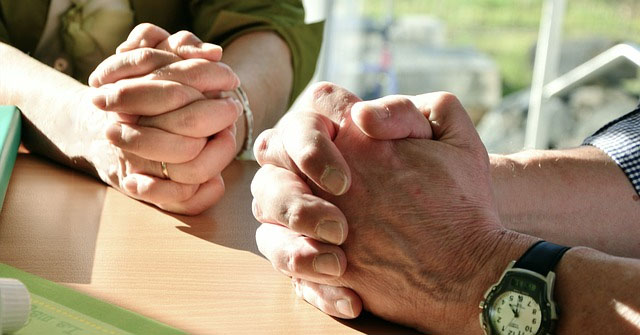 Two Pair of Hands Folded in Prayer
