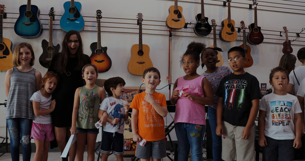 Saturdays at Key to Music - Ms. Bianca and her students after an amazing group vocal lesson!