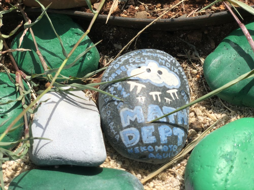 A decorated painted stone that was designed by Ewa Makai's math department.