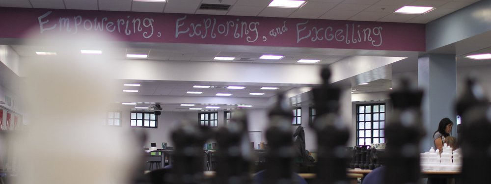 """Empowering, Exploring, and Excelling"" painted in Ewa Makai Middle School's library."