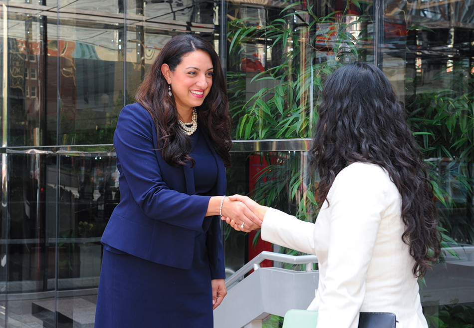 Katherine Mazaheri shaking hands with a customer