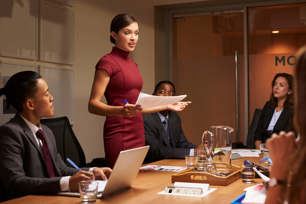woman sharing her ideas with coworkers