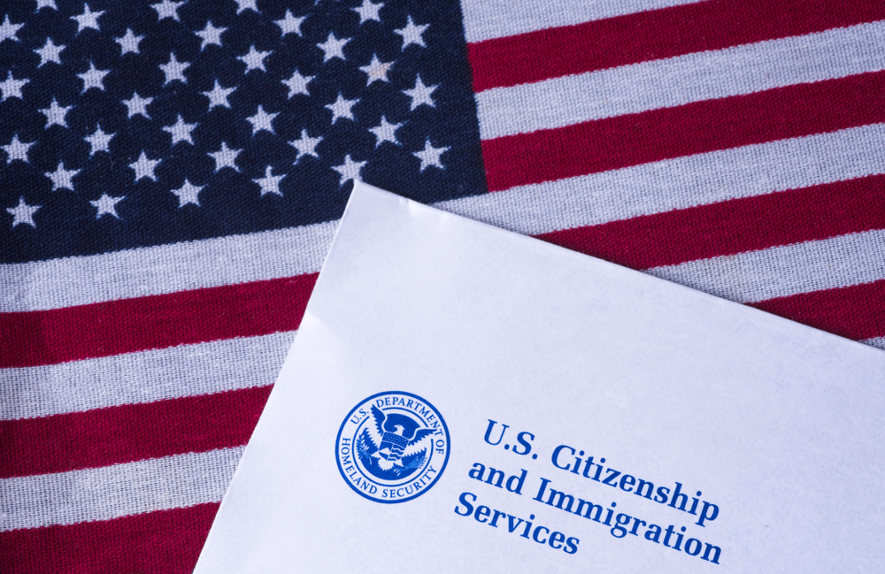 US flag with citizenship and immigration services paper