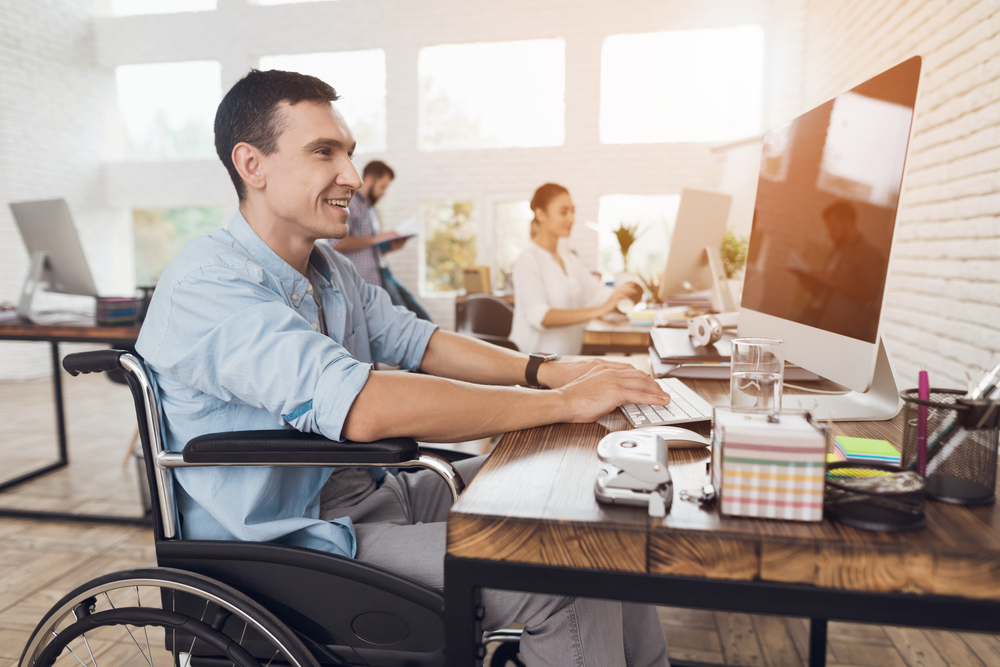 A disable man working in workplace