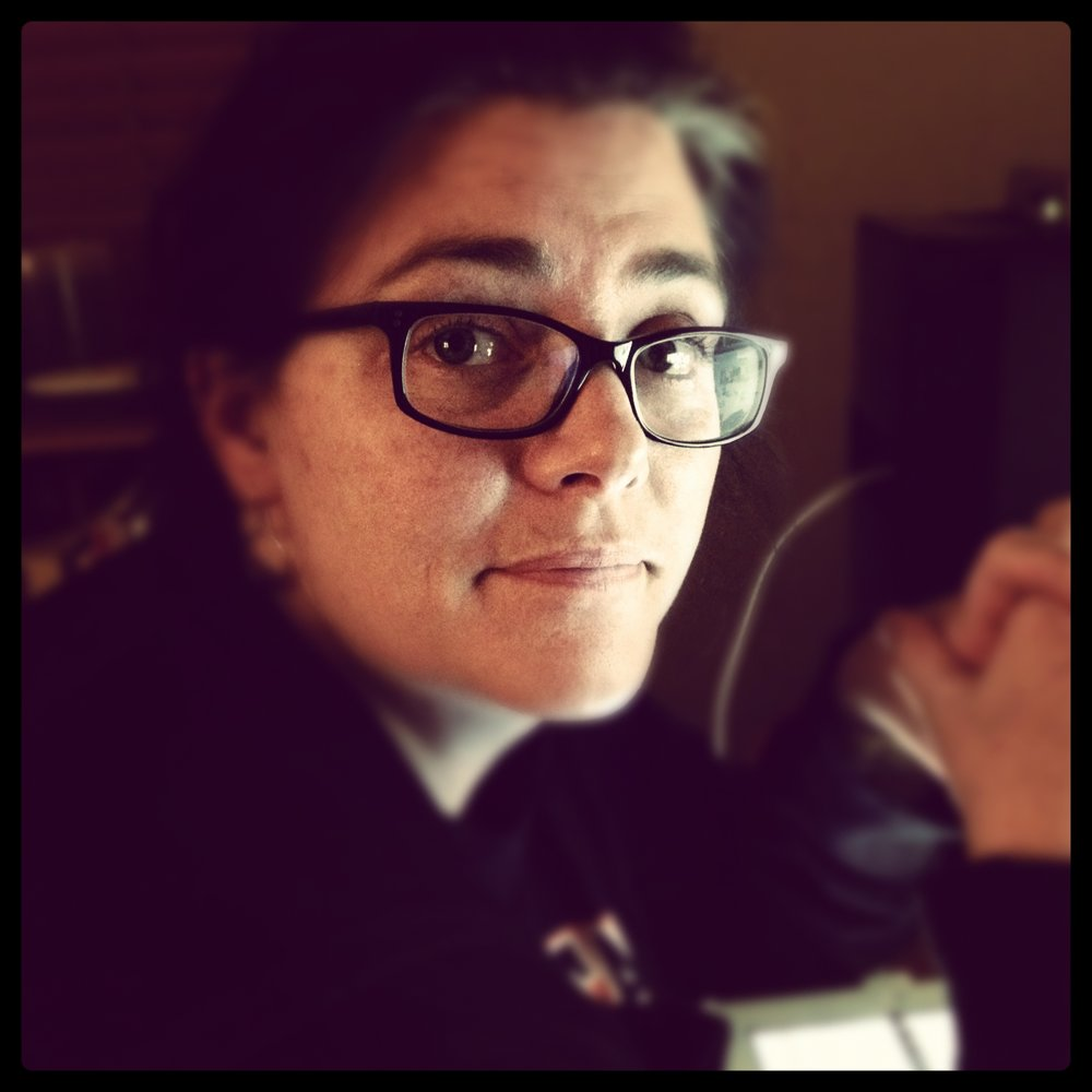 My daughter took this of me - I was sitting at the computer attempting to write. This was about the fifth time she'd interrupted me.