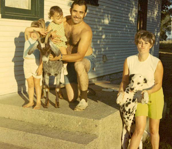 Photo of my parents, sister & me {I'm on the goat} on our first farm. You know you're old when your photos look vintage without using a filter!
