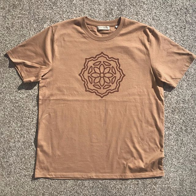 The Huachuma flower in bloom.  Albizia - T-shirt in Caramel & brown. - Hey crew, Im now offering another t shirt and long sleeve available now through my store. In celebration of another solar cycle for myself, and stepping into more wearable creations. To me , this hieroglyph is many things, A small detail that came from the albizia mandala earlier this year, yes , but the blooming of the Huachuma flower in the center of the chest really says it all.  I've chosen some ethical company's to help bring these two shirts into existence, once being organic tees in Mullumbimby,NSW & the other Stanley/Stella. I chose to use there products as there ethos is to respect people, the environment, by initiating change in the textile industry. By making clothing in more humane, ethical and ecological ways. Sweatshop Free!  Also Labels hand stitched by myself onto garment - 100% Organic ring-spun Combed Cotton, Relaxed Fit. Thick Material .  Sizing guide ect all found on my site . www.hazelmandala.com/store  Starting at $45 AUD + post  Thank you for choosing to wear some of my art.  May your life unfold, and bloom in synchronicity 🌵🌸