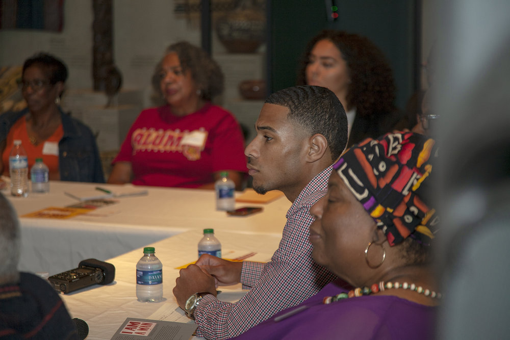 Brother Ali-Smith listens as senior members speak about their experiences during the Civil rights Movement in Knoxville, TN.