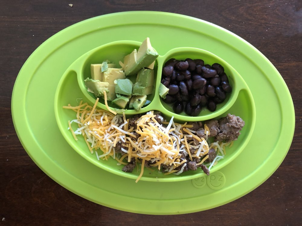 ground beef with sauteed spinach. cheese, avocado, black beans
