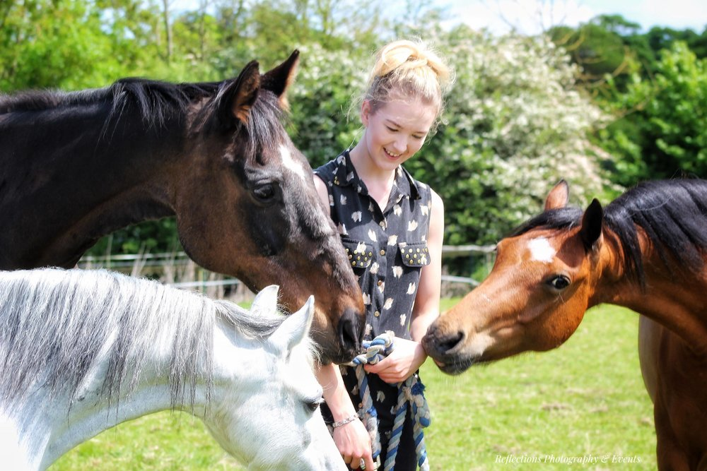 Our head of Riding Stars, Polly, with the horses: Legend (Black), Sparkle (White) and Cracker (Brown)  More about Polly  here…