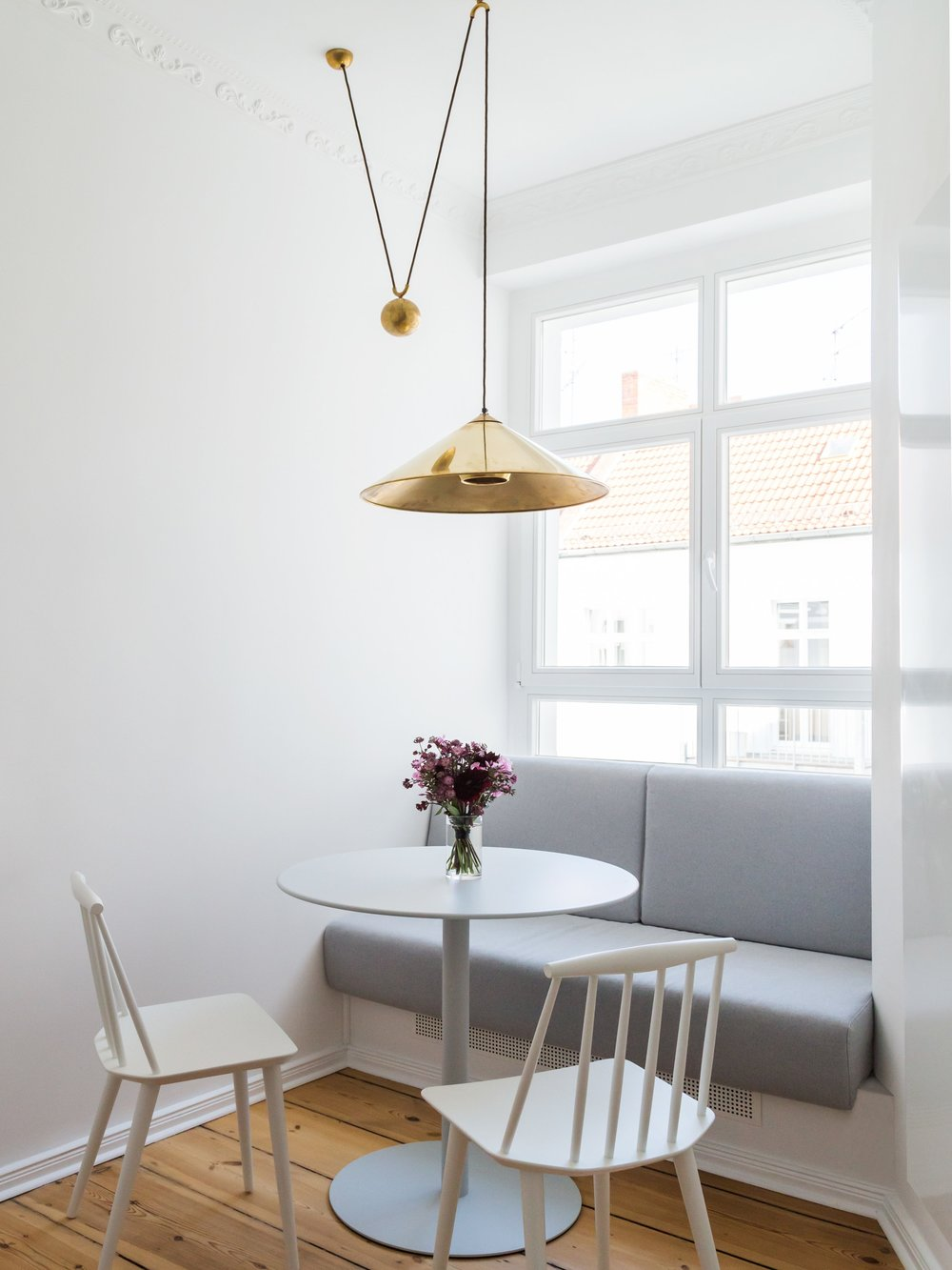 I love this sweet little kitchen nook in this Berlin flat designed by the firm  The White Arrow.  They detailed the seat cushion and the radiator under the window in a very clean way.