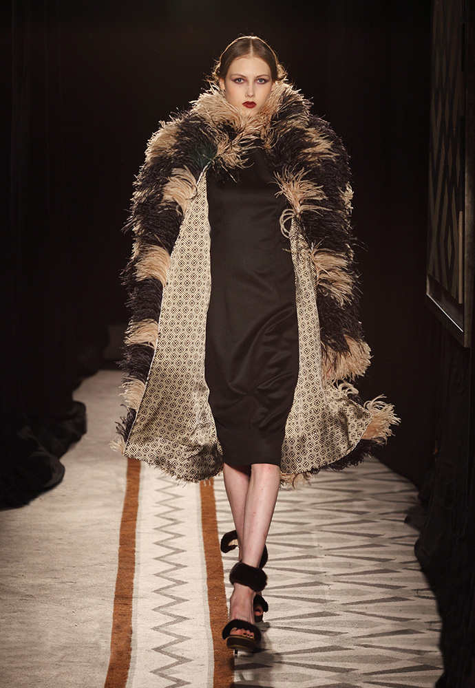 Graphic pattern coat in ostrich feathers with dress in black cashmere
