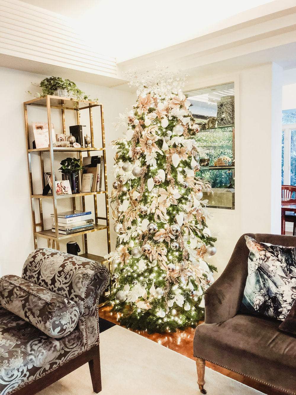 IT'S FEELING A LOT LIKE CHRISTMAS - We can't believe Christmas came so soon! Our Thanksgiving client wanted us to style their home for the holidays and we were just smitten with the chosen theme and colors. We decided to go with rose gold, blush pink, silver, champagne gold and white - a mix of cool and warm just to get that modern feel without losing that hearty feel of the season.We had a 9-foot tree to trim and a whole glass window to style. And we had the dining table and living room table to dress up. We went with tasteful and with just the right amount of decor for each area.