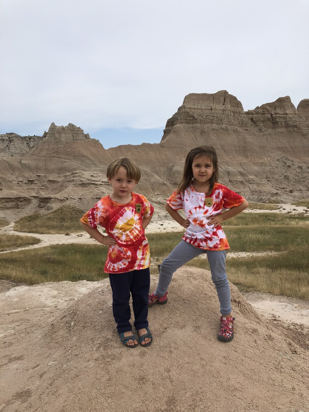 The pose you make after being named a Junior Ranger for the Badlands National Park.