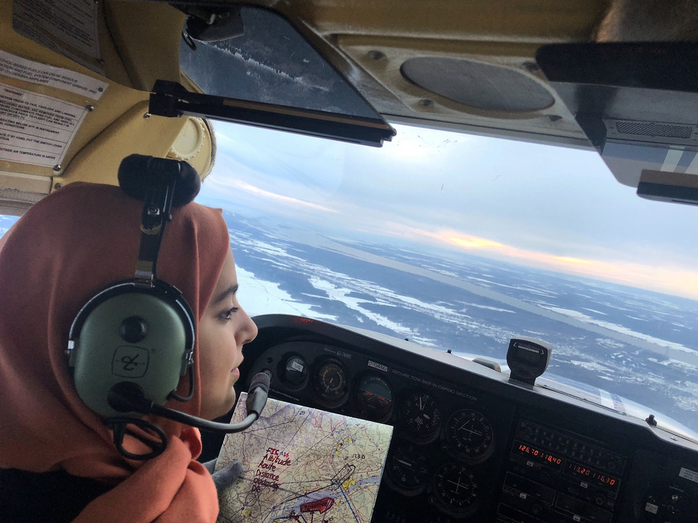 HQ photo of Nour Utayim in cockpit with map.png