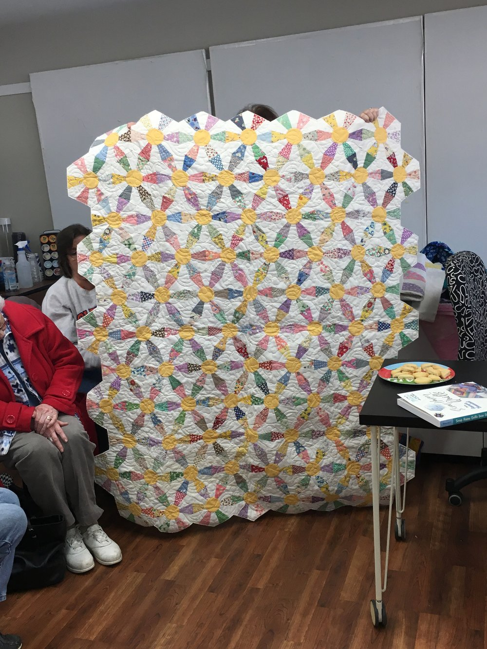 The grand finale from Connie, again. Known as the Pizza quilt but done here in more feed sacks. Note the half cookies on the table brought from Connie as my Half Birthday to share with all. So fun and meaningful to sign lots of my new Scrap Happy Quilts book for fellow quilters. Stay tuned for next month.