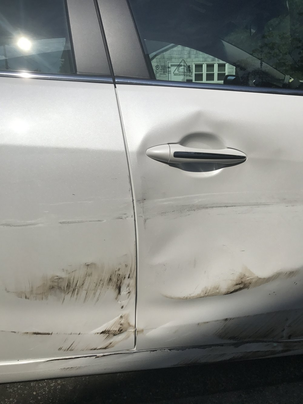 My car after a woman signaled into my lane and side swiped me (no one checks their blind spot)