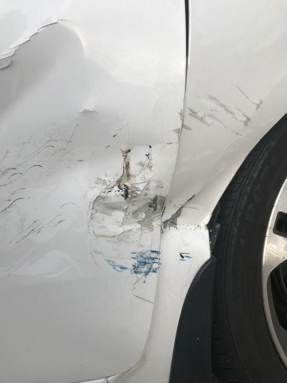 I was unable to open my passenger door due to the impact