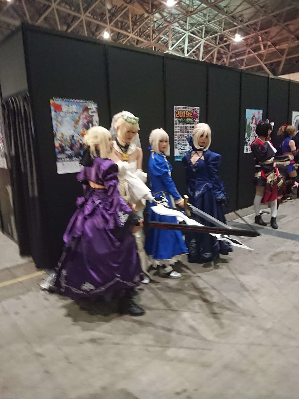 Three Sword Weilding Lady Cosplayers