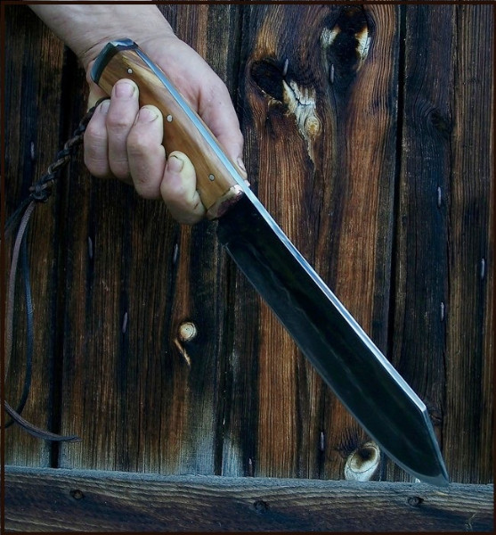 """Hand forged camp knife. 8"""" blade, 1/4 inch spine differentially tempered, steel butt for hammering. Apple wood scales. The Wiseman is a tough bush knife."""