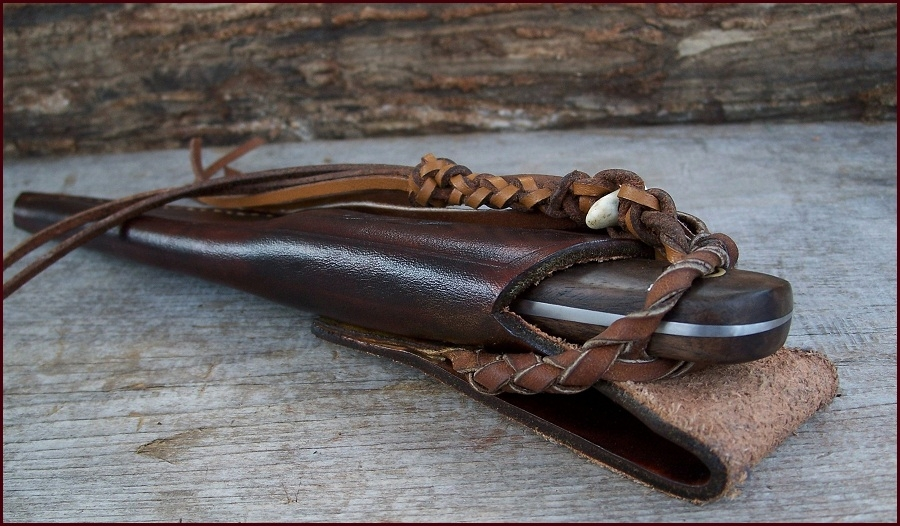 Custom hunting knife secured in it's custom sheath.