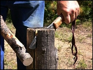 Handmade custom mountain man bush craft knife. Splitting Firewood.