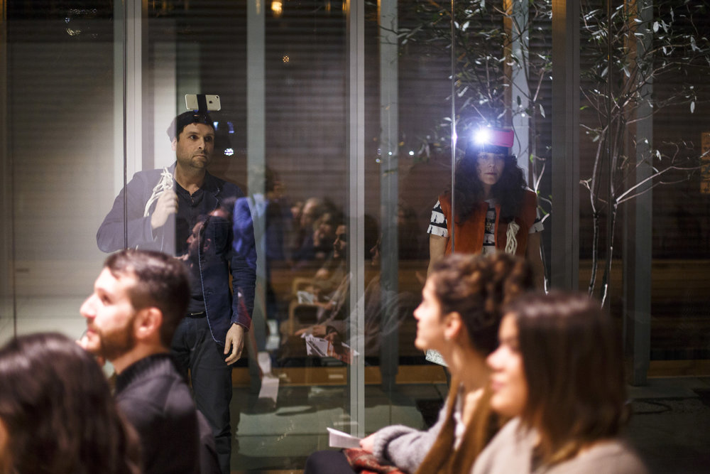 Judd Morrissey and Jennifer Scappettone in performance at Poetry Foundation, with Abraham Avnisan in foreground. Photo courtesy of Grace DuVal.