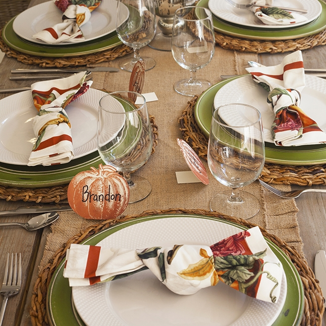 Harvesting Memories - Tablescape Includes:Burlap Table Runner. Rattan Charger, Plate, Green Charger, Napkin, Pumpkin Place Card$14.99 per tablescapeBring an autumn touch to your tablescape with this rustic inspired setting. The burlap runner paired with rich fall colors will leave your guests feeling warm and cozy.