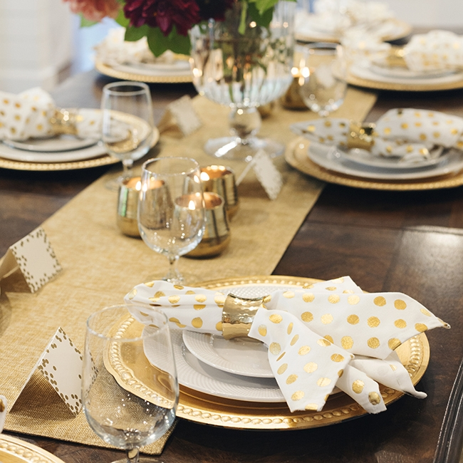 Golden New Year - Tablescape Includes:Gold Table Runner, Gold Charger, Plate, Polka Dot Napkin, Gold Napkin Ring, Place Card$14.99 per tablescapeCelebrate in gorgeous gold style with this stunning elegant table setting. Brilliant, shiny and bright pieces will bring a fun and trendy vibe to your dinner party.