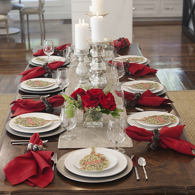Merry Mistletoe - Table Setting Includes:Platinum Table Runner, Platinum Patina Charger, Napkin, Napkin Ring, Mistletoe Place Card$14.99 per table settingThis fun and festive tablescape brings the joy of the holidays to you dinner party. Beautiful silver and posh platinum hues are accented by cranberry red and mistletoe cards to complete this holiday look!