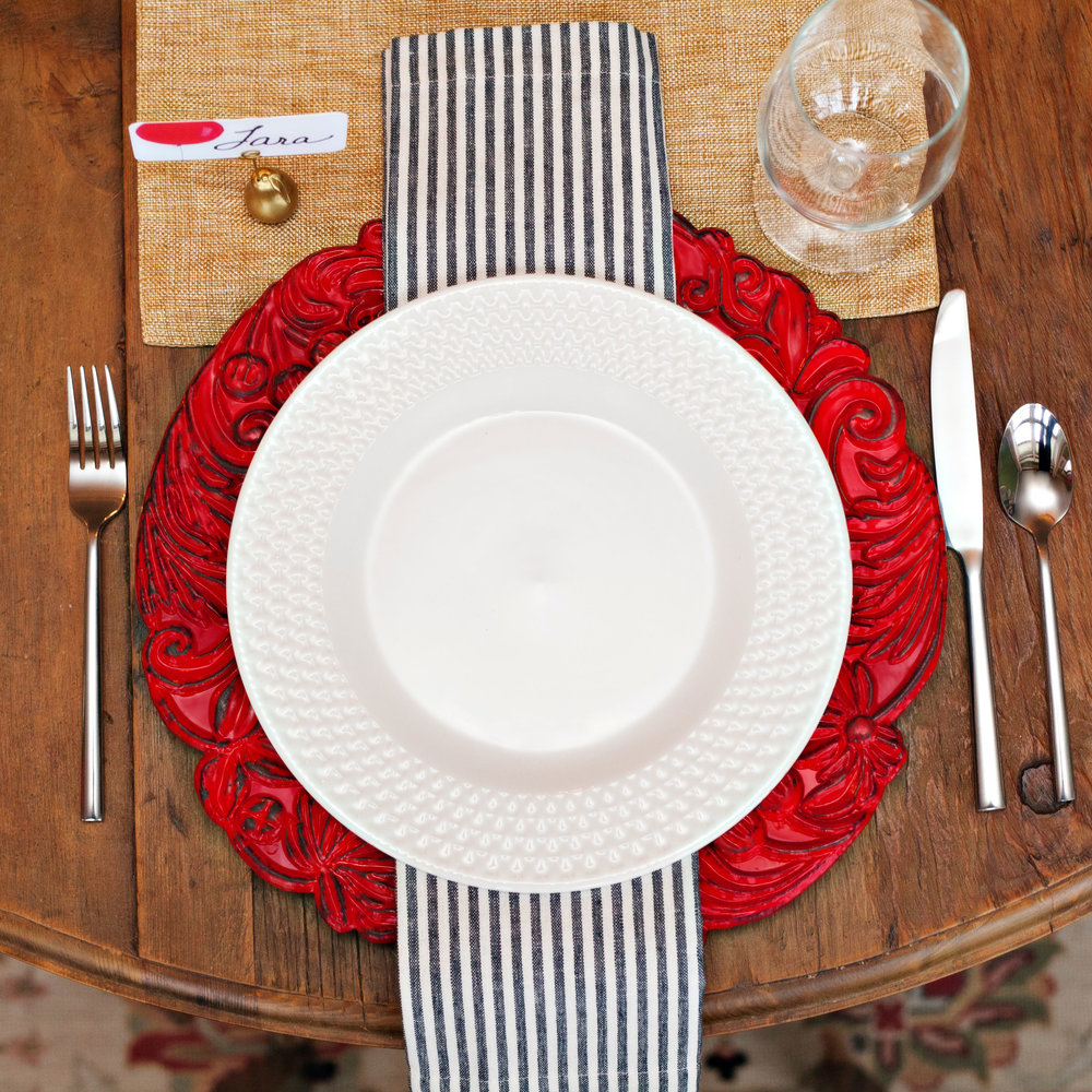 Up Up and Away - Table Setting Includes:Gold Table Runner, Red Intricate Charger, Napkin, Place Card Holder, and Place Card$9.99 per table settingA cheerful Table Setting to gather at home with your friends and family, accentuated by a red balloon Place Card for your guests to find their seat. This tablescape is a perfect theme for any occasion; birthday, anniversary, 'You Are Special' gatherings for adults and children, alike!