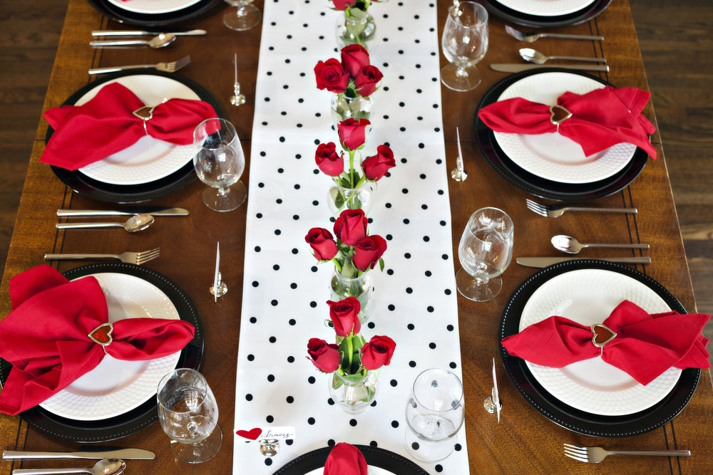 A Heart-felt Occasion - Tablescape Includes:Black and white polka dot runner, black charger, plate, heart shaped napkin ring, heart shaped place card holder with heart place card$14.99 per tablescapeRed and hearts make this table setting a perfect choice for a Valentine's Day gathering! The festive heart theme, with the bright red hues, add a loving feel to your gathering. Perfect for an engagement party, and anniversary dinner, too!