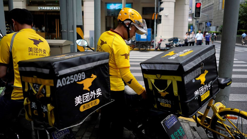 Drivers of food delivery service Meituan in Shanghai. Photo: Reuters