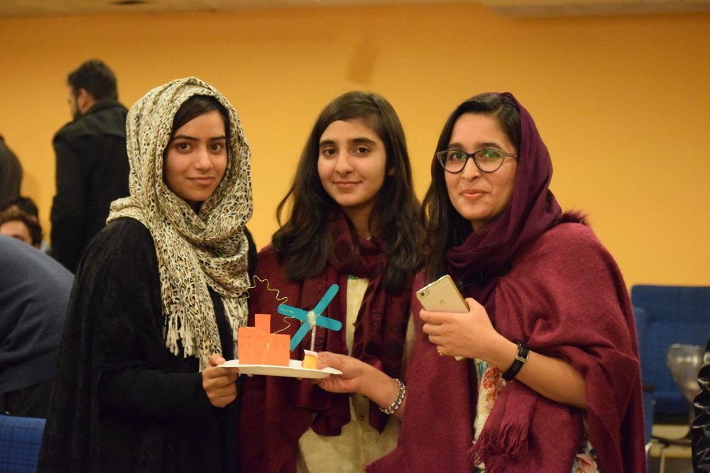 "Students pose with a ""prototype"" of their design addressing climate change at a ""Design for Pakistan"" workshop at COMSATS in Islamabad."