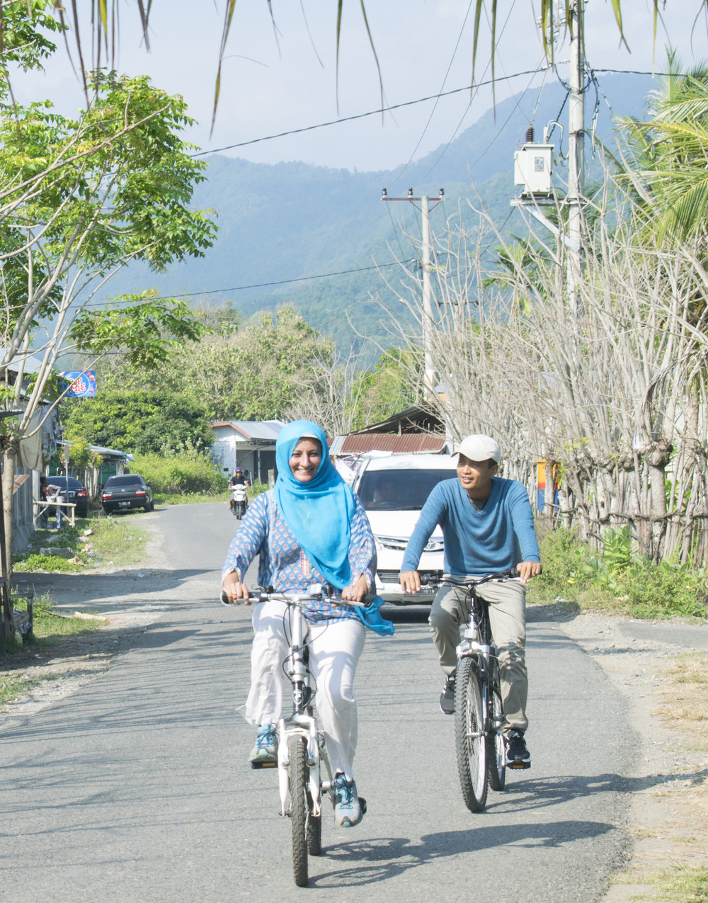 Fulbright and East-West Center alumna, Dr. Feriyal on a bike ride in Aceh as part of the 'Women on Wheels' initiative.