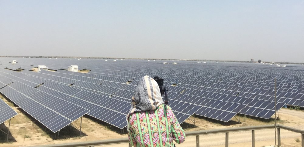 Haya capturing a shot of Quaid-e-Azam Solar Park in Bahawalpur while filming Fulbright alumnus, Najam Ahmed Shah's documentary. Najam was CEO of the solar park, considered one of the largest solar energy plants in the world. The pilot project is Pakistan's first 100 MW solar power plant and its success has paved the way for private investment in Pakistan's solar energy sector, an essential contribution in addressing the country's chronic power shortage. A career civil servant, Najam now serves as Secretary, Specialized Healthcare and Medical Education with the Government of Punjab.
