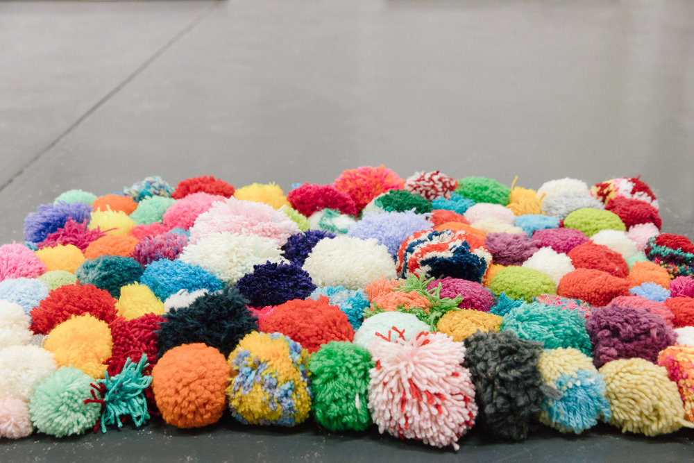 Pip Lincolne, pom-pom rug, installation view,  Handle With Care,  2018, Soul Craft Festival, Melbourne. Photo courtesy Soul Craft Festival.