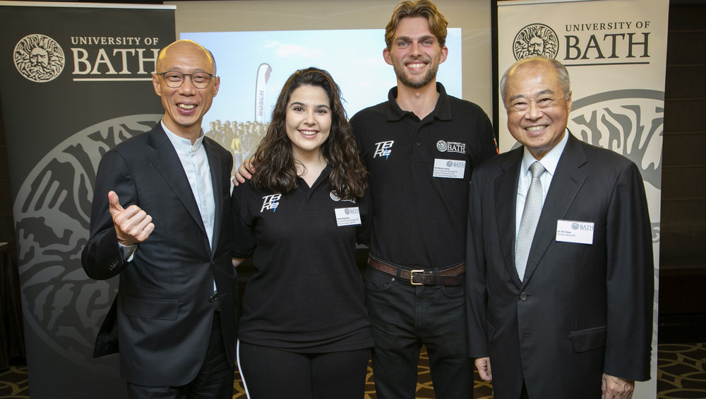 Hong Kong's Secretary for the Environment, Mr Wong Kam-sing, GBS, JP (left) and honorary graduate and former Chairman of Hong Kong Exchanges and Clearing, Sir CK Chow (right) with Team Bath Racing Electric members Natalie Kyprianou and Will Minter-Kemp