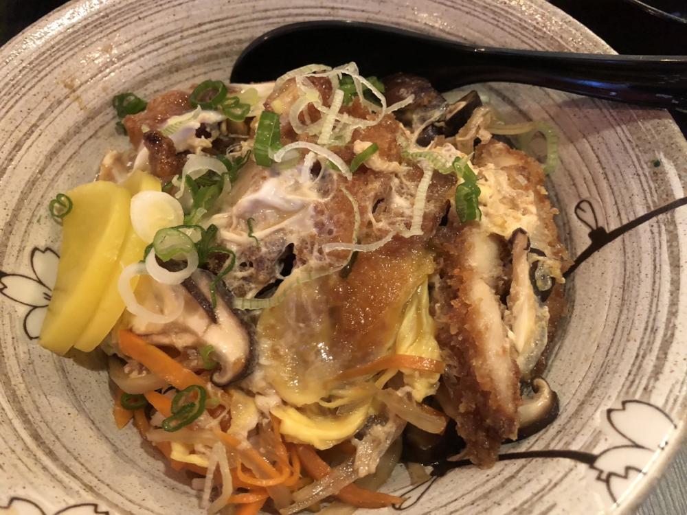 A  katsu-don  (deep fried pork bowl).