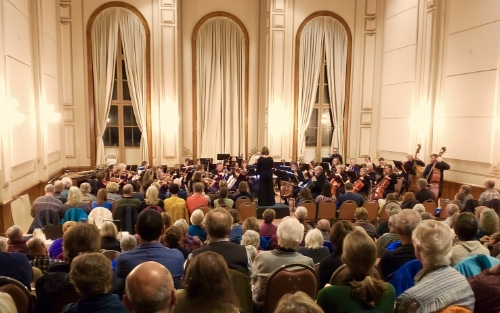 Audience watches the Montpelier Chamber Orchestra perform at the Vermont College of Fine Arts Chapel in Montpelier, Vermont.