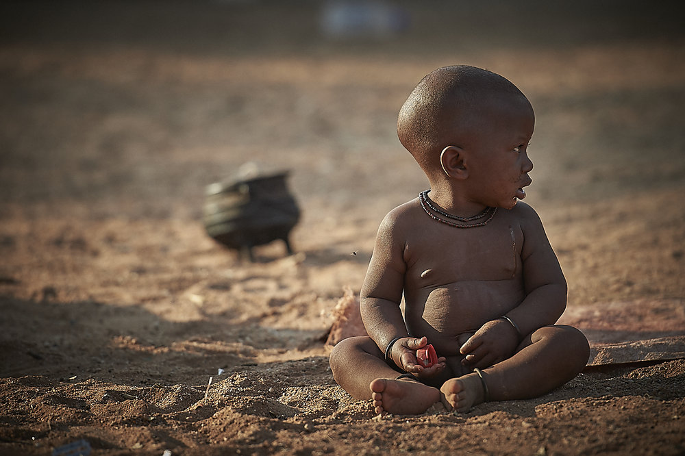 very young himba children are left, pretty much alone, throughout the day, to care for themselves.  women have their hands full with the daily household and village chores.