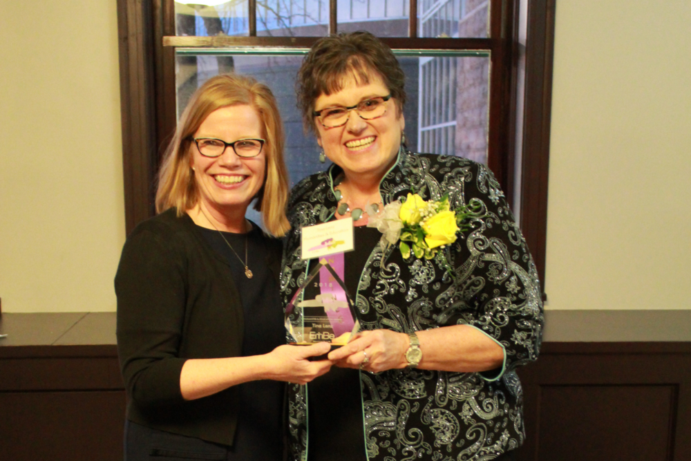 Mrs. Tina Lenz, Fantastic Fives teacher at Sioux Falls Lutheran School, poses with administrator Tia Esser after EmBe's 2018 Tribute to Women event.