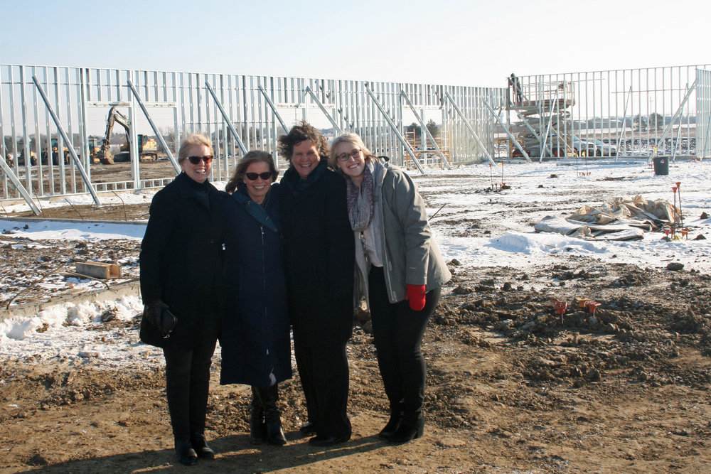 Dr. Rebecca Schmidt, Mrs. Tia Esser, Mrs. Lee Wagner, and Mrs. Kristy Bridges visit the new Sioux Falls Lutheran School site on December 7.