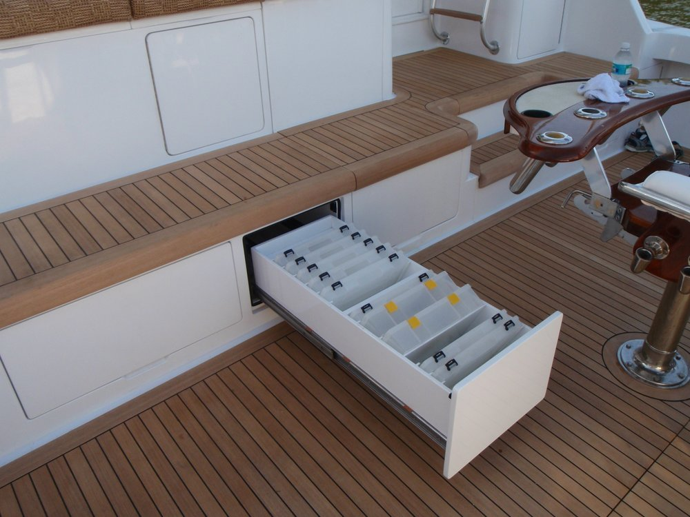 65' Viking custom tackle storage and teak deck.