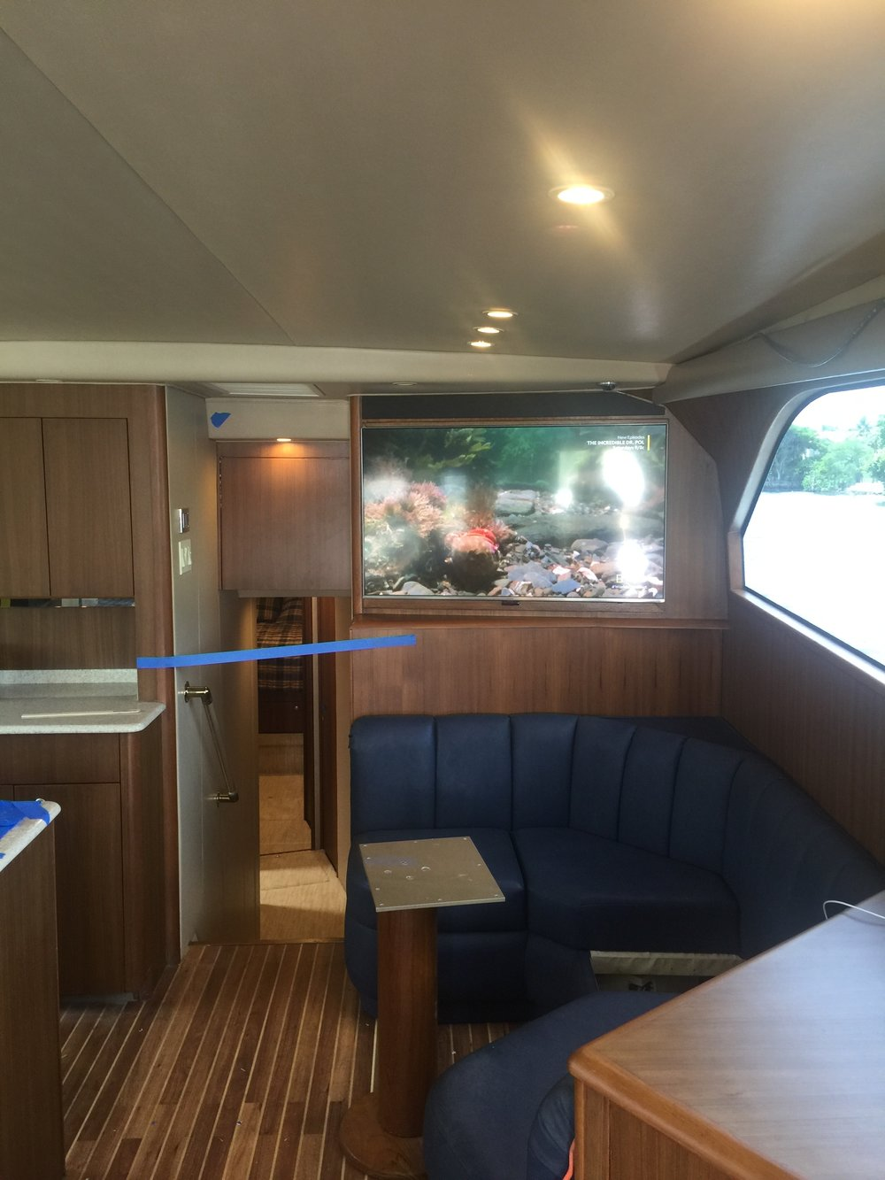 52' Viking wood refinish from high gloss to satin and custom TV installation.