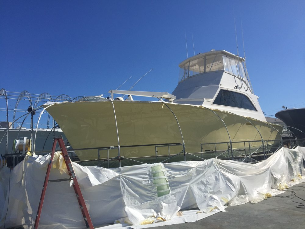 "The ""Intimidator"" being prepped and covered for a fresh paint job. The following three images are the same vessel."