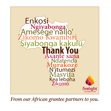 An outline of the continent of Africa is covered with thank you written in multiple languages in various colors.