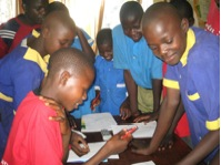 Child leaders smiling and working